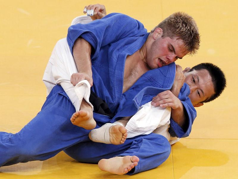 Nicholas Delpopolo (L) of the US (blue) fights with South Korea's Wang Ki-Chun during the men's -73kg quarter-final judo match at the London 2012 Olympic Games in a file photo. Delpopolo has been expelled from the Olympic Games after testing positive for marijuana. Reuters photo/Kim Kyung-Hoon