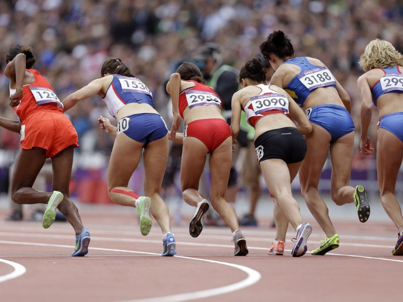 Athletes start in a women's 1500-meter heat during the athletics in the Olympic Stadium at the 2012 Summer Olympics, London. (AP Photo/Lee Jin-man)