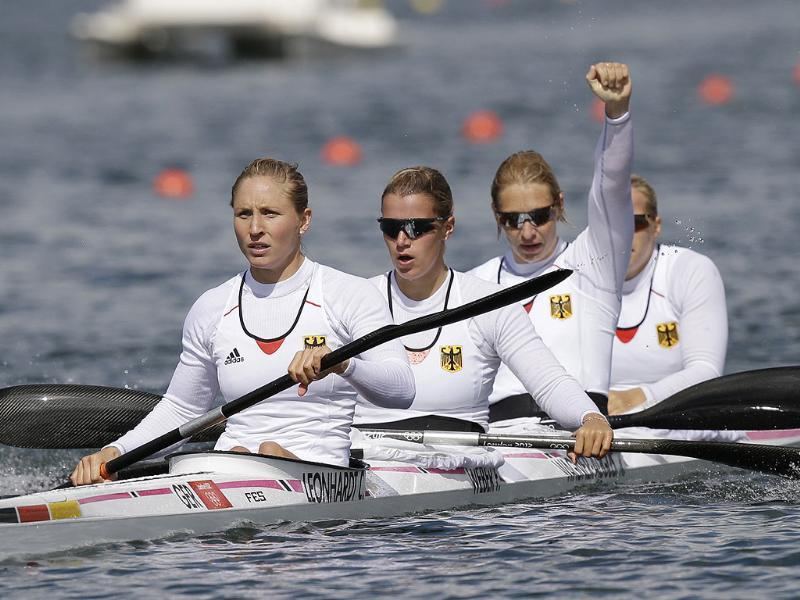 Germany's, left to right, Carolin Leonhard, Franziska Weber, Katrin Wagner-Ausutrin and Tina Dietze celebrate after winning a women's kayak four 500m heat in Eton Dorney, near Windsor, England, at the 2012 Summer Olympics. (AP Photo/Armando Franca)