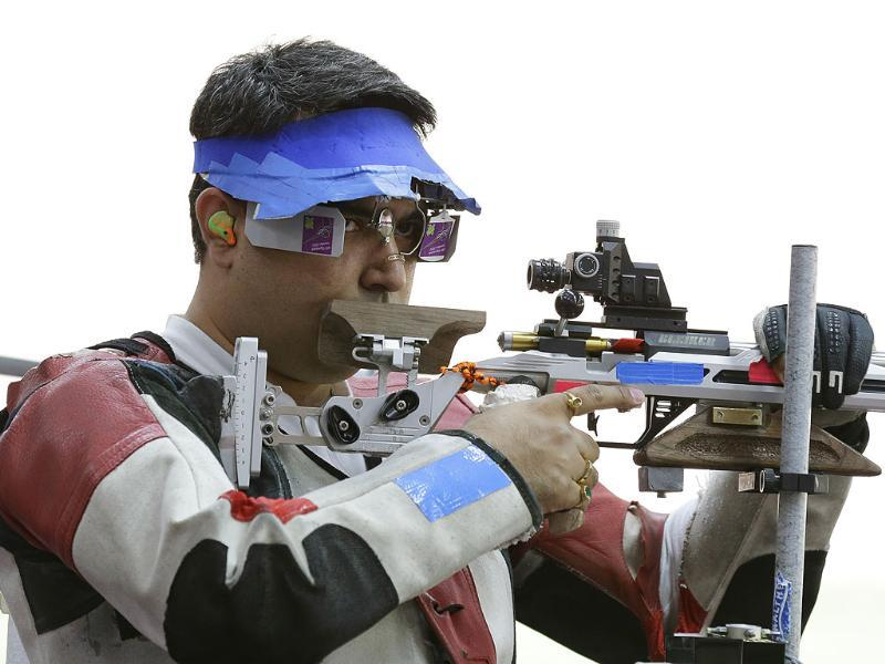 India's Gagan Narang prepares to shoot, during qualifiers for the men's 50-meter rifle 3 positions, at the 2012 Summer Olympics in London. (AP Photo/Rebecca Blackwell)