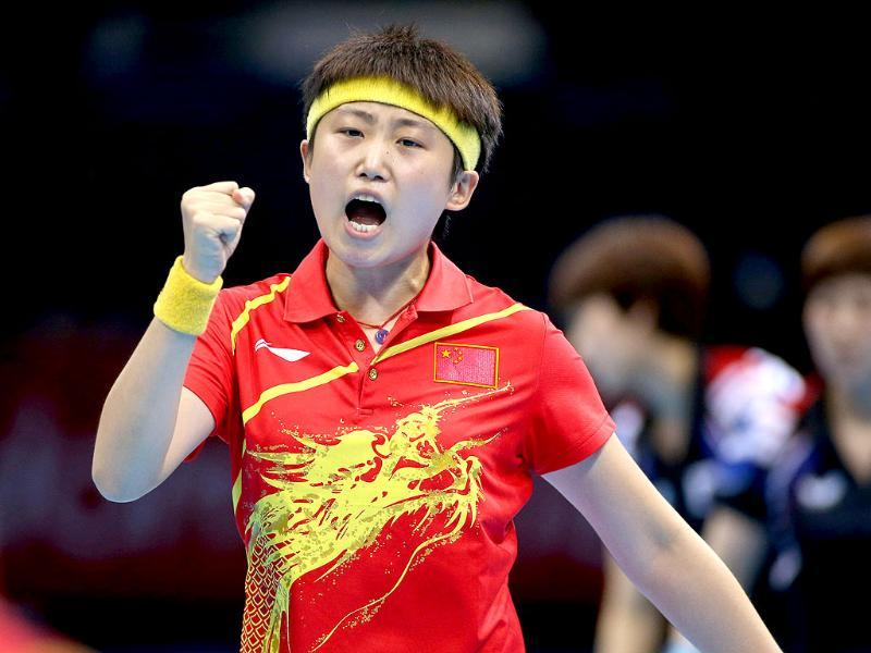 China's Yue Guo reacts during a match against South Korea's Dang Yeseo and Seok Hajung in a women's team table tennis semifinal at the 2012 Summer Olympics in London. (AP Photo/Sergei Grits)