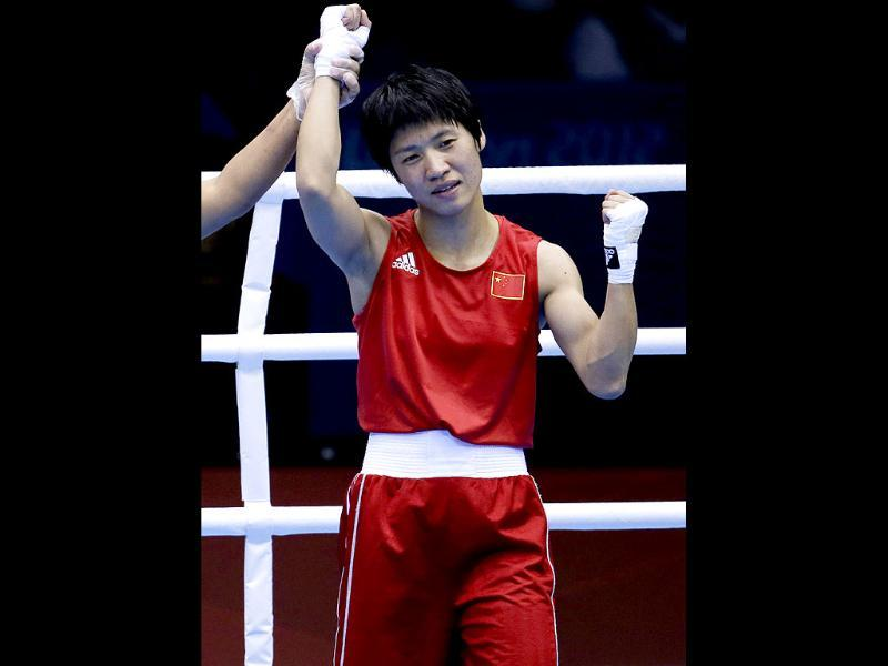 China's Ren Cancan celebrates after defeating Russia's Elena Savelyeva in a women's flyweight 51-kg quarterfinal boxing match at the 2012 Summer Olympics in London. (AP Photo/Mike Groll)