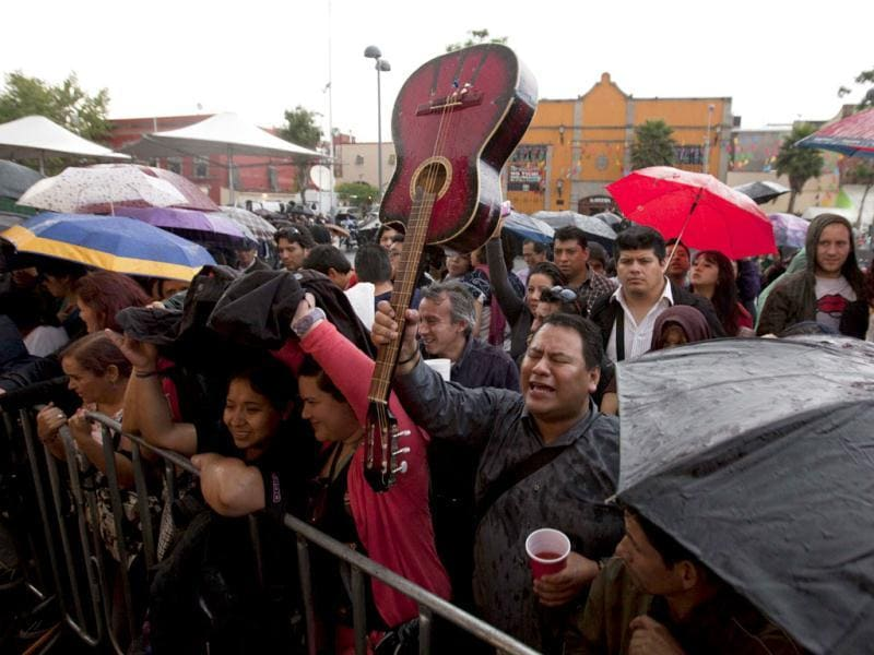 People sing and cheer during a homage to famed Mexican singer Chavela Vargas at the traditional Mariachi Garibaldi Plaza in Mexico City. AP Photo/Eduardo Verdugo