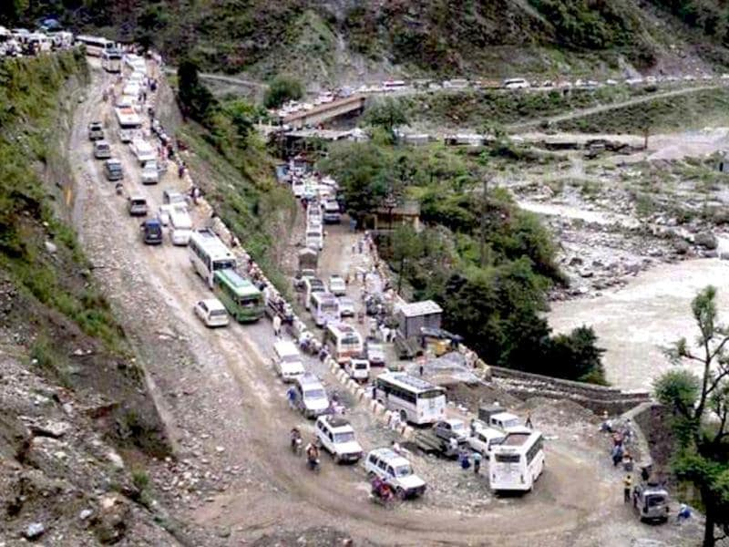 Vehicles stranded in mud on a highway after cloud burst and heavy rains in Uttarkashi. PTI Photo