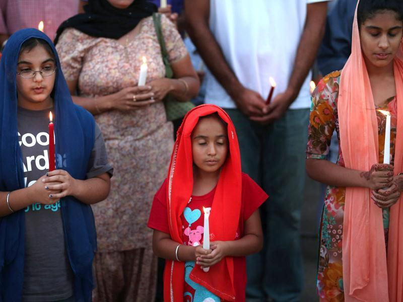 Guests attend an interdenominational candlelight vigil at the Illinois Sikh Community Center in Wheaton, Illinois. AFP/Scott Olson