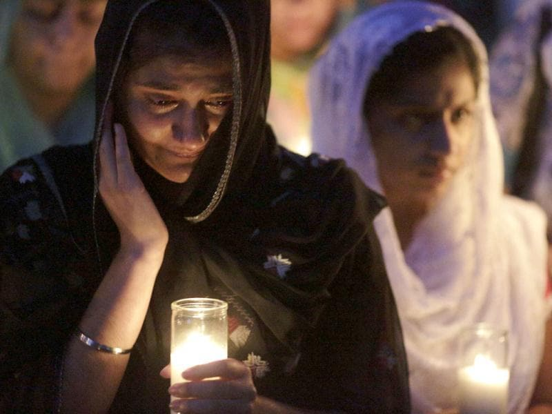 Mourners cry during a candlelight vigil at the Sikh Temple in Brookfield, Wisconsin. Reuters/John Gress