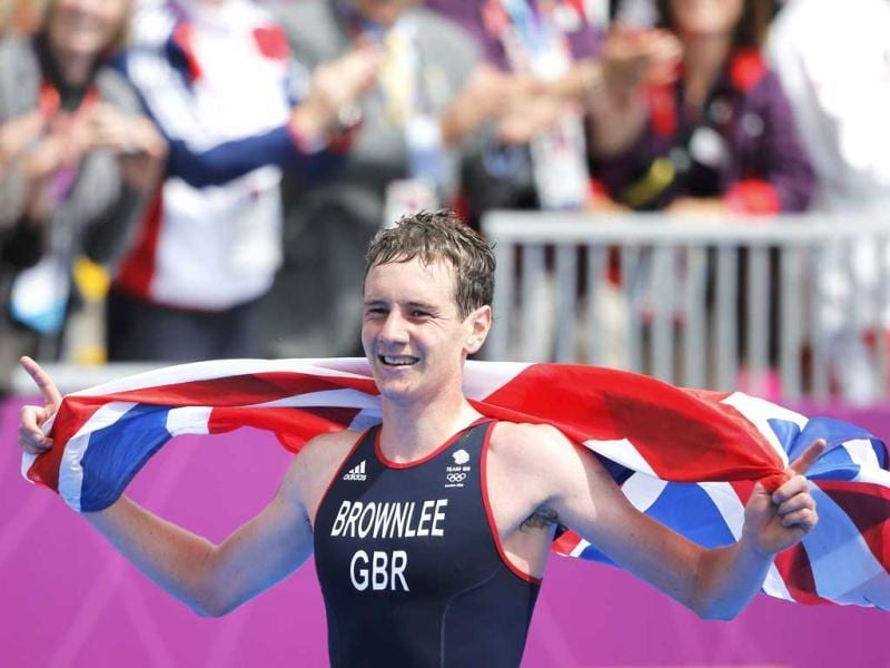 Britain's Alistair Brownlee celebrates after winning in the men's triathlon final during the London 2012 Olympic Games at Hyde Park. (Reuters/Jorge Silva)