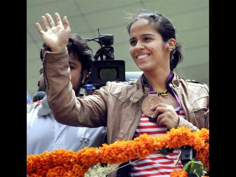 Olympic bronze medallist shuttler Saina Nehwal on her arrival at the Rajiv Gandhi International Airport Shamshabad near Hyderabad. (PTI Photo)