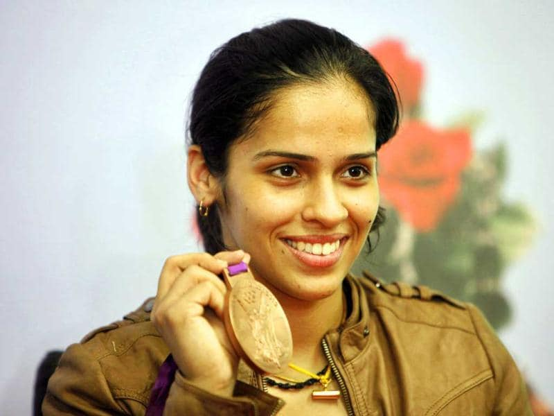 India's badminton player Saina Nehwal displays her bronze medal at a press conference in Hyderabad. Nehwal won the medal in the women's singles at the 2012 Summer Olympics. (AP Photo/Mahesh Kumar A)