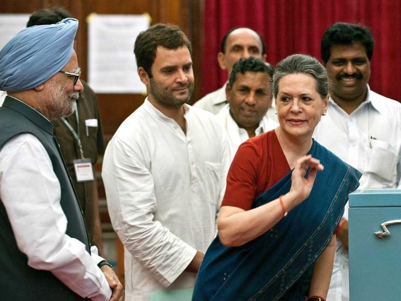 Congress general secretary Rahul Gandhi (2L) and Prime Minister Manmohan Singh (L) watch as Sonia Gandhi casts her vote during the election for Vice President, at the Parliament in New Delhi. AFP/Prakash Singh