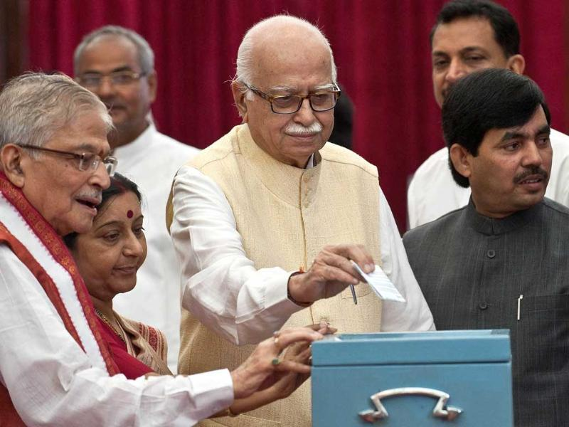 Senior Bhartiya Janata Party leader LK Advani casts his vote during the election for Vice President, at the Parliament House. AFP/Prakash Singh