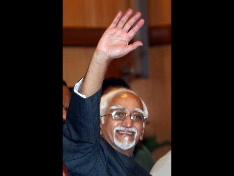 Mohammad Hamid Ansari waves after he was re-elected as Vice President of India, at his residence in New Delhi. PTI/Subhav Shukla