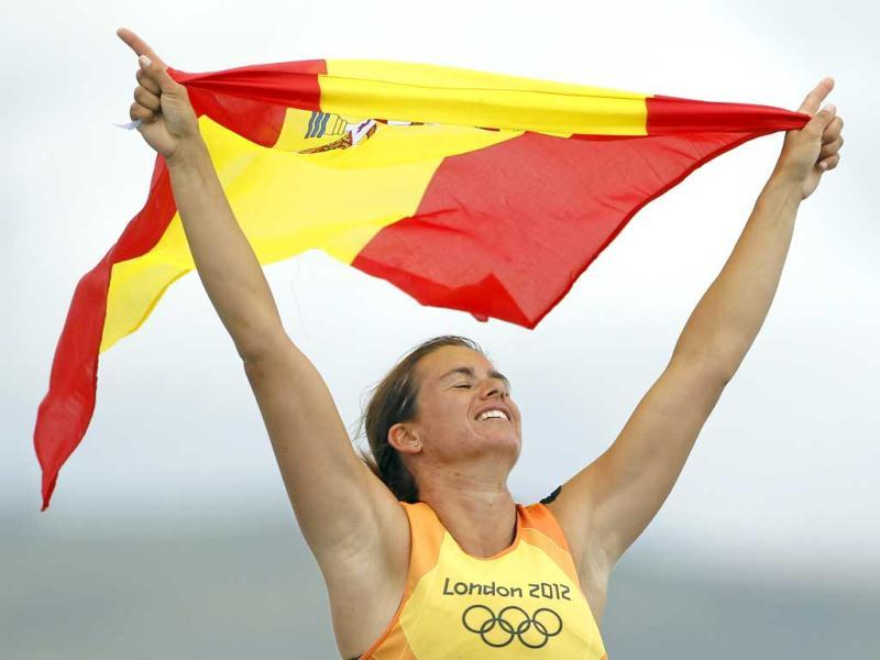 Spain's Marina Alabau celebrates after crossing the finish line to win the women's RS-X sailing class during the medal race at the London 2012 Olympic Games in Weymouth and Portland, southern England. (Reuters/Benoit Tessier)