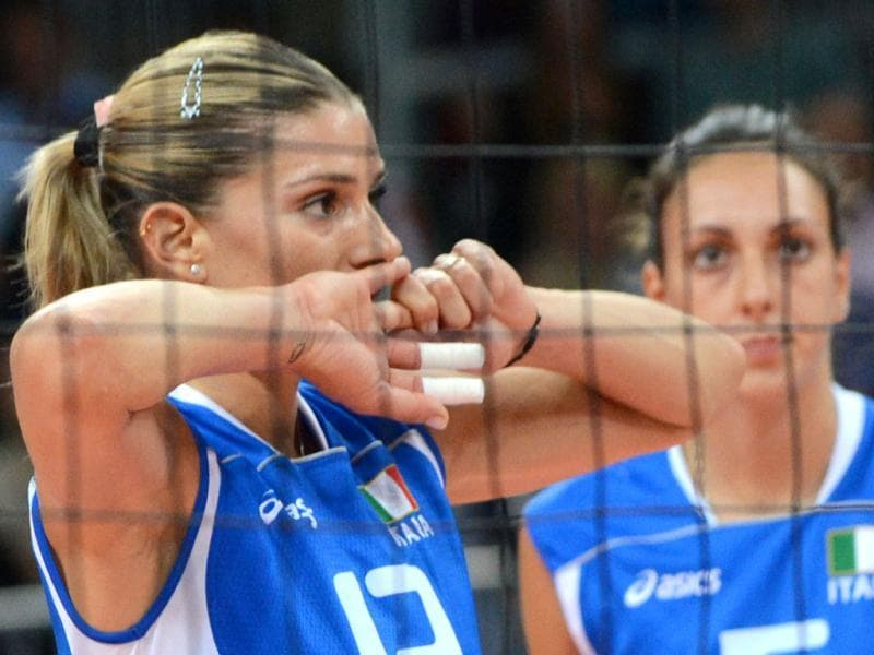 Italy's Francesca Piccinini (L) reacts during the Women's quarterfinal volleyball match between Italy and South Korea in the 2012 London Olympic Games in London. AFP Photo
