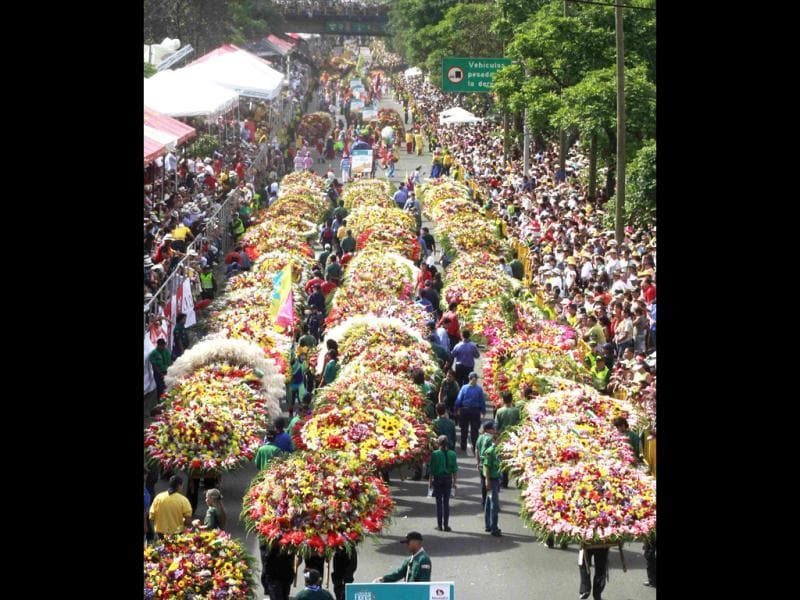 Dozens of flower growers, known as Silleteros, carry decorative garlands of flowers during the parade in Medellin. (Reuters)
