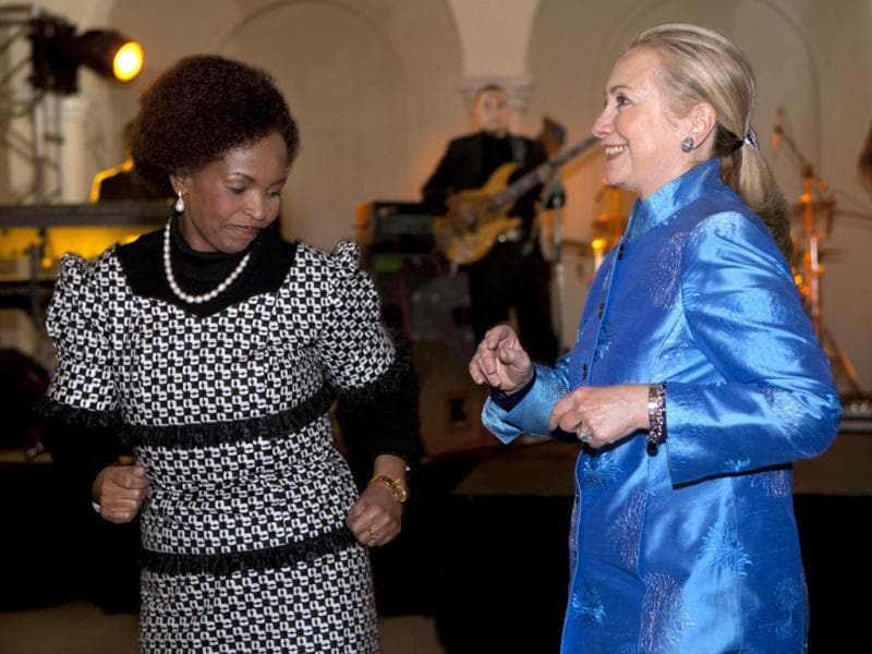 South Africa's Foreign Minister Maite Nkoana-Mashabane, left, dances to African music with US Secretary of State Hillary Rodham Clinton during a gala dinner at Sefako M. Makgatho Presidential Guest House in Pretoria, South Africa. (AP Photo)