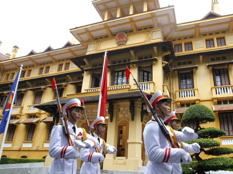 Honour guards march past the Association of Southeast Asian Nations (ASEAN) flag and Vietnamese flag after a flag raising ceremony to mark the 45th anniversary of the regional group at Vietnam's Ministry of Foreign Affairs in Hanoi. (Reuters)