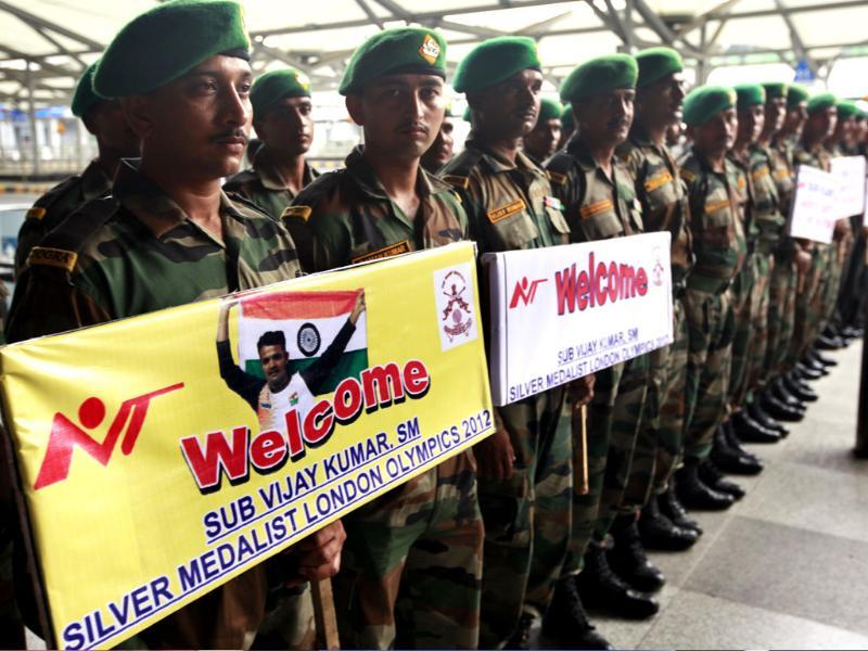 Army soldier stand outside the IGI Airport to welcoming London Olympics 25-m rapid fire pistol silver medalist Subedar Vijay Kumar on his arrival at the Indira Gandhi International Airport. Raj K Raj/Hindustan Times