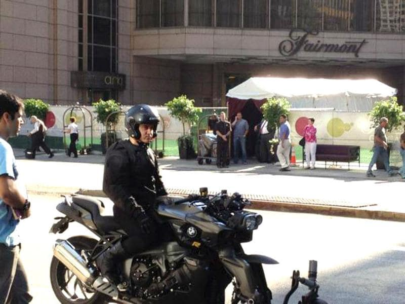 Aamir Khan vrooming on a black BMW K1300R bike.