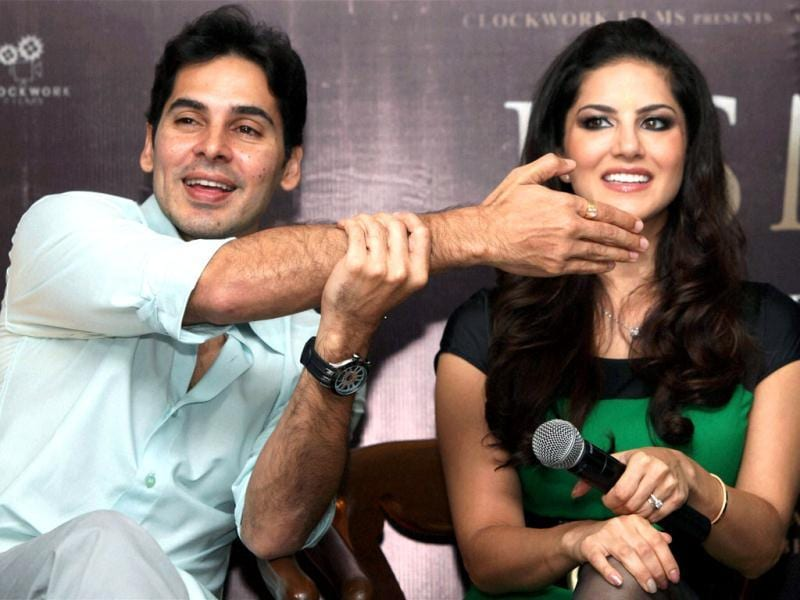 Canadian actress Sunny Leone and Bollywood actor Dino Morea smile during a function to promote their new movie Jism-2 in Kolkata on August 7, 2012. Leone an Indian/ Canadian porn star makes her Bollywood debut in what is expected to be one of India's raunchiest mainstream movies, which is already raising eyebrows in the sexually conservative country. (Photo: AFP )
