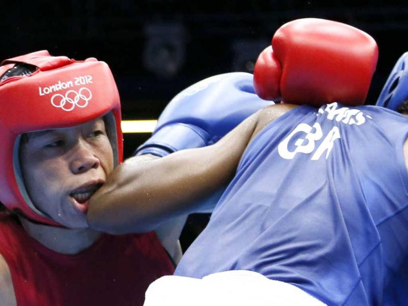 MC Mary Kom (in red) defends against Nicola Adams of Great Britain during the women's Flyweight boxing semi-finals of the 2012 London Olympic Games at the ExCel Arena in London. AFP/Jack Guez