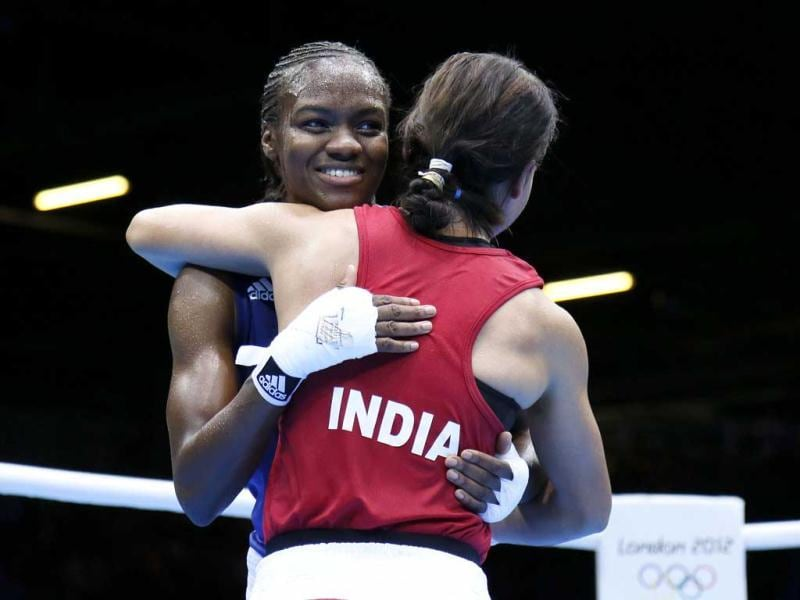Mary Kom is embraced by Nicola Adams following their women's Flyweight boxing semi-final match of the 2012 London Olympic Games. AFP/Jack Guez