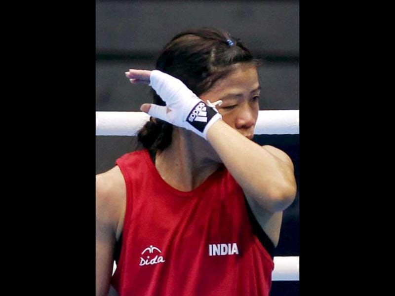 A disappointed MC Mary Kom after losing to Nicola Adams in the semi-final of women's Flyweight boxing at Olympic Games in London. PTI/Manvender Vashist