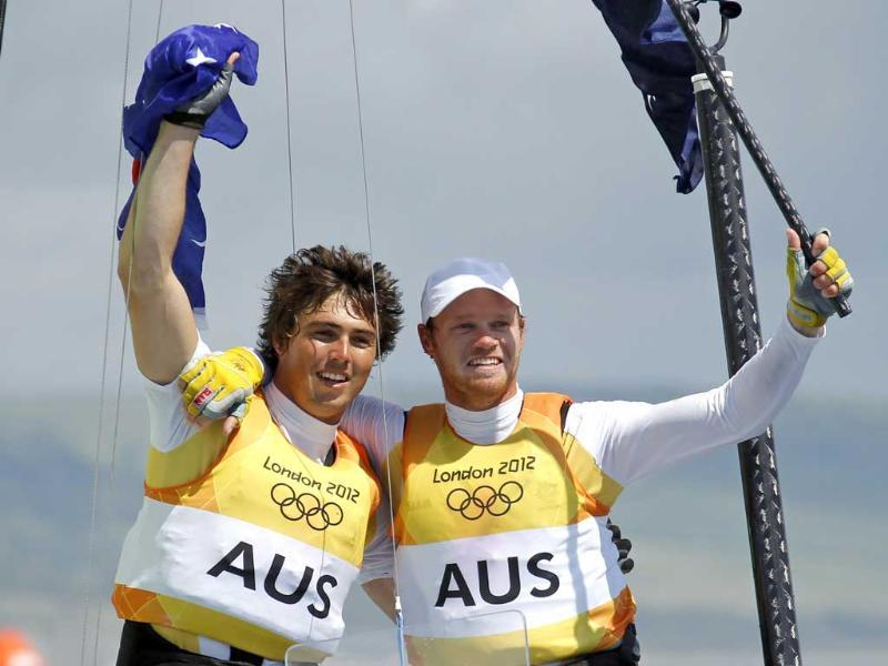Australia's Nathan Outteridge and Iain Jensen (L) celebrate as they cross the finish line to win gold in the 49er sailing class at the London 2012 Olympic Games in Weymouth and Portland, southern England. (Reuters/Benoit Tessier)