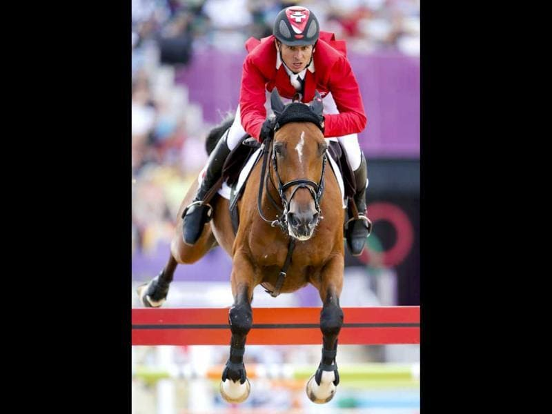 Steve Guerdat of Switzerland riding Nino des Buissonnets performs during the equestrian individual jumping final at the London 2012 Olympic Games in Greenwich Park. (Reuters/Jorge Silva)