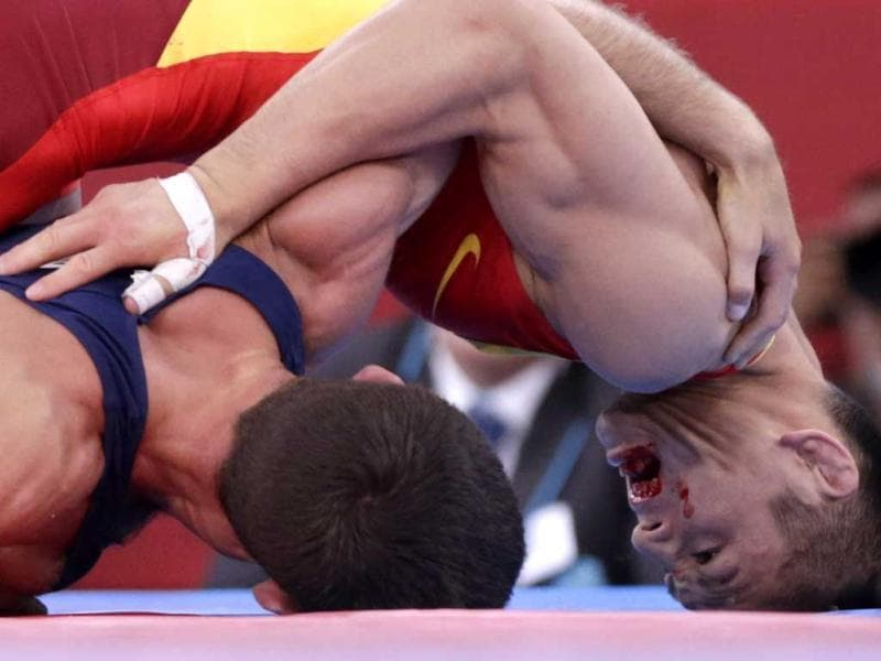 Azerbaijan's Rovshan Bayramov (in blue) fights with China's Shujin Li on the Men's 55Kg Greco-Roman wrestling at the ExCel venue during the London 2012 Olympic Games. Reuters photo/Toru Hanai