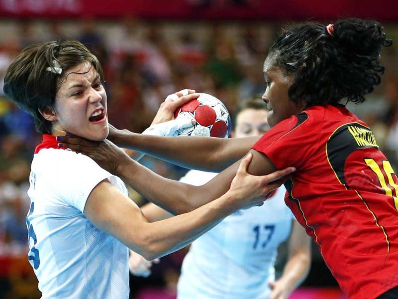 Britain's Marie Gerbron is challenged by Angola's Marcelina Kiala in their women's handball Preliminaries Group A match at the Copper Box venue during the London 2012 Olympic Games. Reuters photo/Marko Djurica