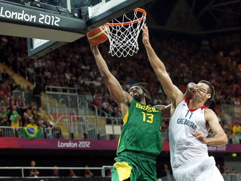 Brazil's Nene Hilario (L) tries to score against Great Britain's Joel Freeland during their men's preliminary round Group B basketball match at the Basketball Arena during the London 2012 Olympic Games. Reuters photo/Sergio Perez