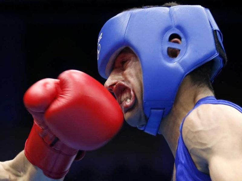 Nordine Oubaali of France (L) fights against Afghanistan's Ajmal Faisal in the men's Fly (52kg) Round of 32 boxing match at the ExCeL venue during the London 2012 Olympic Games. Reuters photo/Murad Sezer