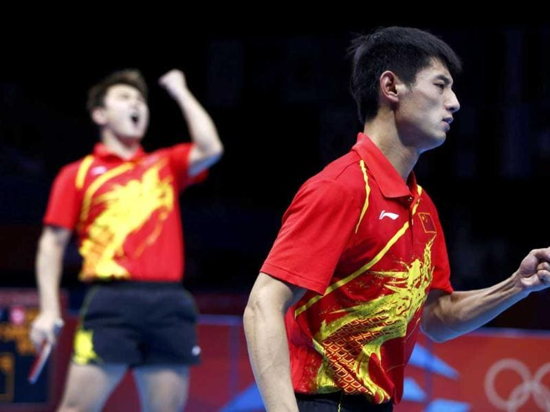 China's Zhang Jike (R) and team mate Wang Hao celebrate their victory in their men's team gold medal table tennis doubles match against South Korea's Ryu Seungmin and team mate Oh Sangeun at the ExCel venue during the London 2012 Olympic Games. (Reuters/Grigory Dukor)