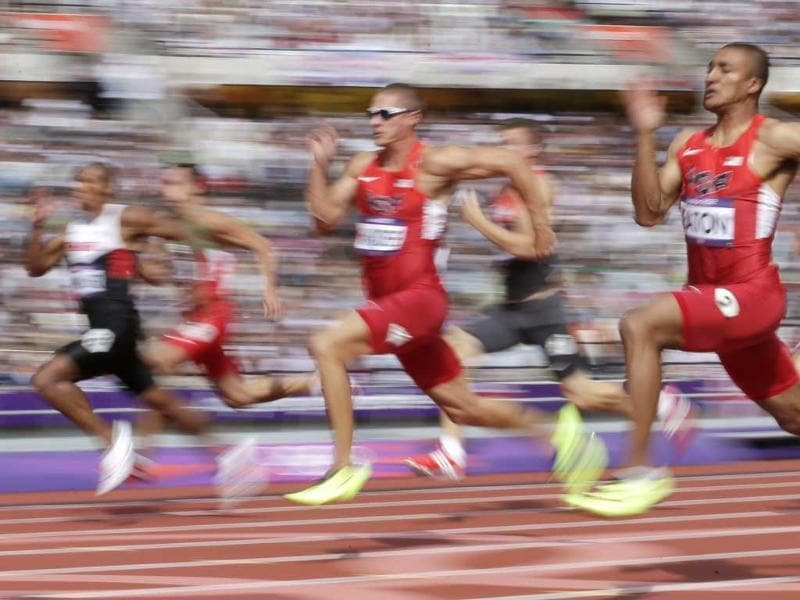 United States' Ashton Eaton, center, competes in the 100-meter decathlon during the athletics in the Olympic Stadium at the 2012 Summer Olympics, London. (AP Photo/David J. Phillip)