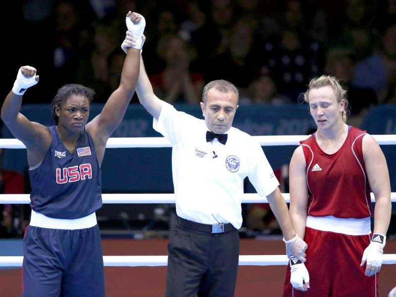 Claressa Shields of the US (L) celebrates after being declared the winner over Kazakhstan's Marina Volnova following their Women's Middle (75kg) semi-final boxing match at the London Olympic Games August. (Reuters/Murad Sezer)