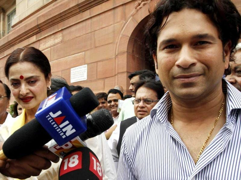 Rajya Sabha MP Sachin Tendulkar with actress Rekha at the monsoon session of Parliament in New Delhi. HT/Arvind Yadav