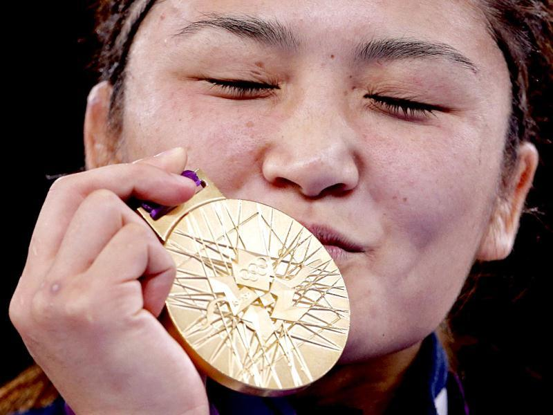 Japan's Kaori Icho kisses her gold medal at the podium of the Women's 63Kg Greco-Roman wrestling at the ExCel venue during the London 2012 Olympic Games. Reuters Photo