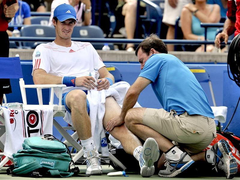 Andy Murray of Britain has his left knee worked on during a medical time-out in his match against Flavio Cipolla of Italy at the Toronto Masters tennis tournament in Toronto. Reuters Photo