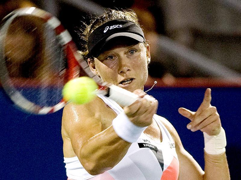 Australia's Samantha Stosur returns the ball to Simona Halep, from Romania, during the Rogers Cup women's tennis tournament in Montreal. AP Photo