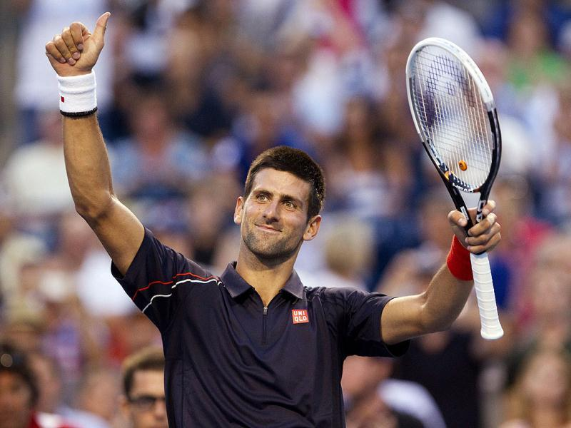 Serbia's Novak Djokovic celebrates after defeating Australia's Bernard Tomic 6-2, 6-3 during their match at the Rogers Cup men's tennis tournament in Toronto. AP Photo