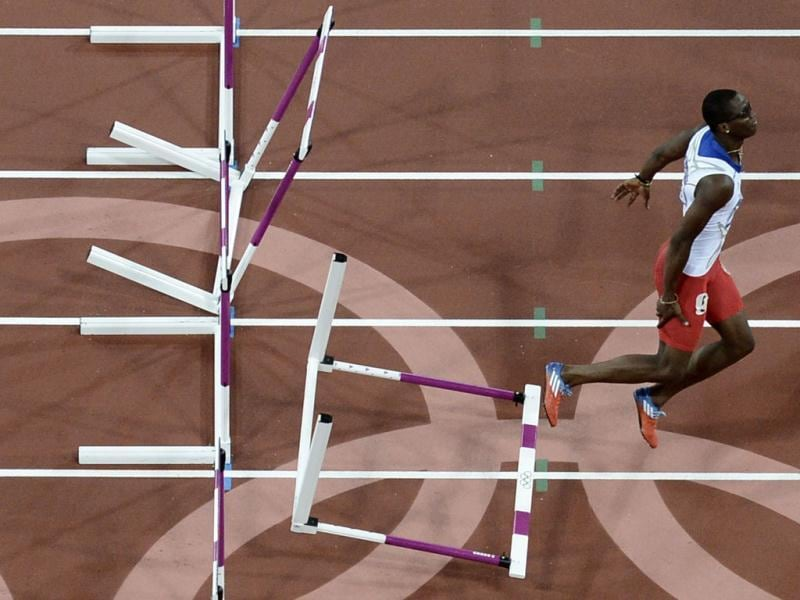 Cuba's Dayron Robles fails during the men's 110m hurdles final at the athletics event of the London 2012 Olympic Games in London. AFP/Francois Xavier Marit