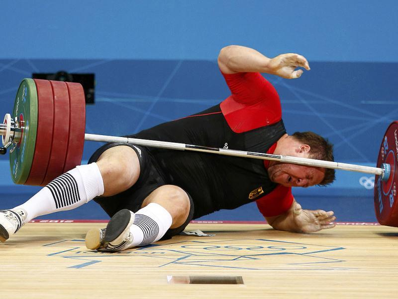 Germany's Matthias Steiner is struck by his falling weight after he dropped it during the men's +105kg Group A snatch weightlifting competition at the ExCel venue during the London 2012 Olympic Games. Reuters/Grigory Dukor