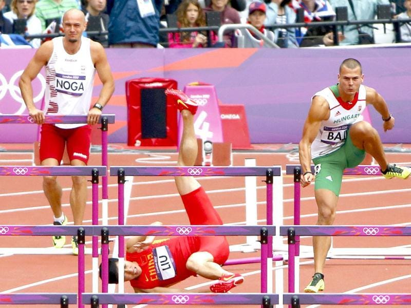 China's Liu Xiang falls while competing in his men's 110m hurdles round 1 heat during the London 2012 Olympic Games at the Olympic Stadium. Reuters/David Gray