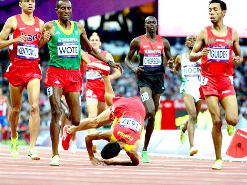 Spain's Diego Ruiz falls during in the men's 1500m heats at the athletics event during the London 2012 Olympic Games in London. AFP/Olivier Morin