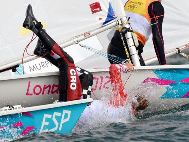 Croatia's Tina Mihelic falls from her dinghy in the Laser Radial sailing class at the London 2012 Olympic Games, in Weymouth. AFP/William West