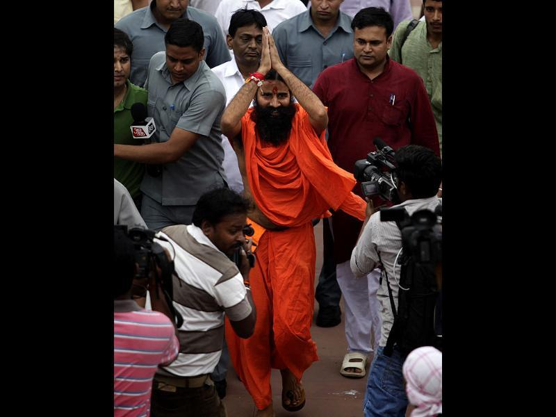 Yoga guru Baba Ramdev gestures as he arrives to pay homage at Rajghat, the memorial to the late Mahatma Gandhi, before relaunching his anti-corruption protest in New Delhi. AP/Altaf Qadri