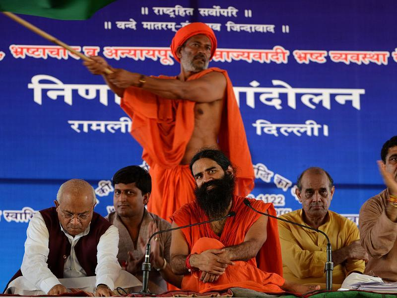 Baba Ramdev (C) gestures as he sits on a protest in New Delhi. AFP/Sajjad Hussain