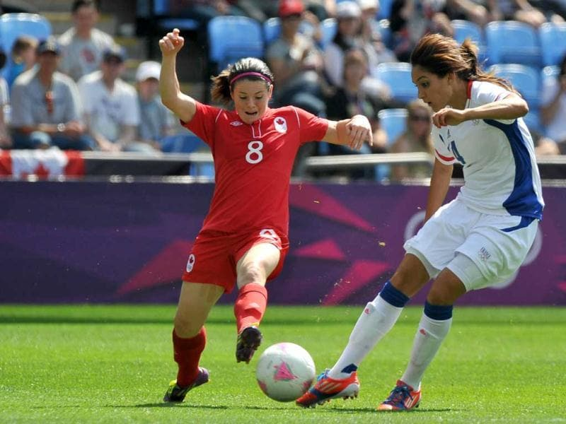 Canada's midfielder Diana Matheson (L) fights for the ball with France's Louisa Necib during the women's football match for bronze of the London 2012 Olympic Games at the City of Coventry stadium in Coventry. AFP Photo/Paul Ellis