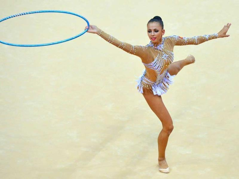 Russia's Daria Dmitrieva performs her hoop program during the individual all-around qualifications of the rhythmic gymnastics event of the London Olympic Games at Wembley arena in London. AFP/Ben Stansall